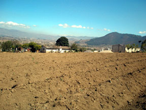Vista of fields and small houses in rural Guatemala