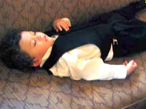 The two-and-a-half-year-old ringbearer crashes at the reception