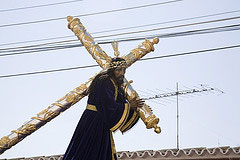 Man carrying a cross in Lenten parade