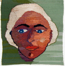 Tapestry of a woman's face half in the shadow