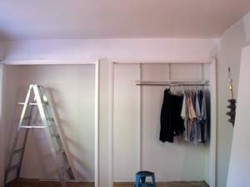 Ladder with paint can on the floor in the closet