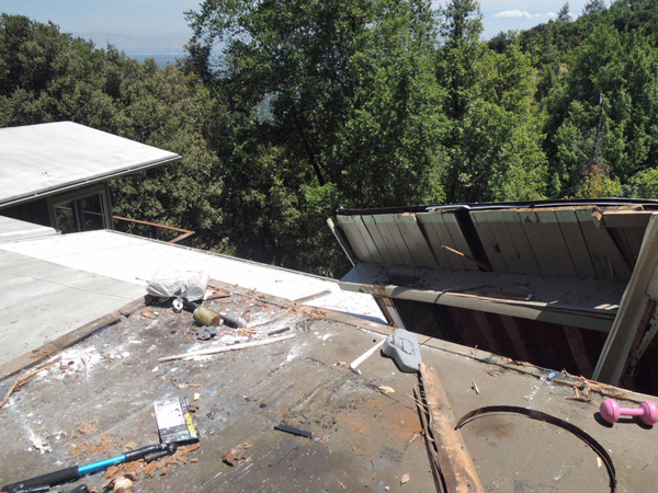 The garage floor with the roof of the house below