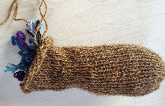 stuffing a leg with yarn scraps